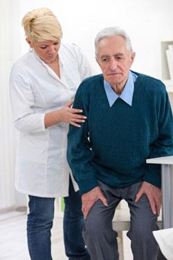 unhappy older man with nurse