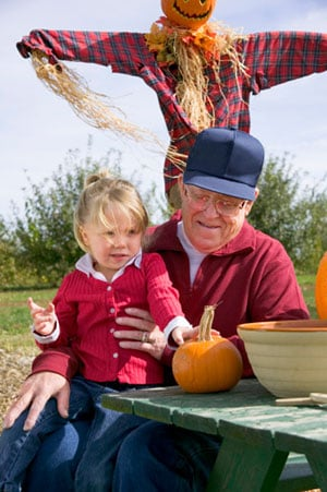 elderly-carving-pumpkins