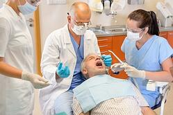 Dentist with Senior Patient
