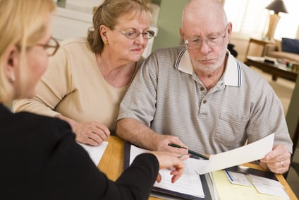 senior couple going over financial papers