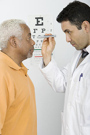 Senior eye doctor