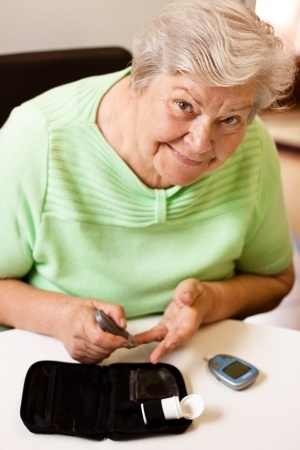 Senior woman checking her blood sugar