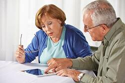 seniors looking over affordable care act