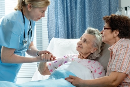 Senior and caregiver in hospital