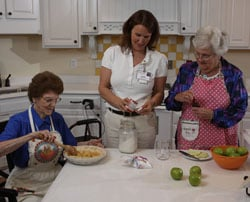 Judi Dean baking with residents of Deupree's senior care Cottages