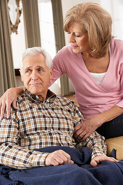 Mature woman trying to comfort an older man.