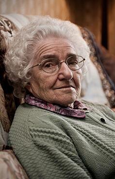 Elderly woman sitting in an easy chair