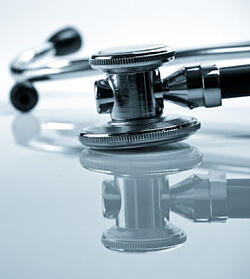 stethoscope on a reflective surface
