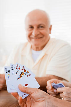 Group of seniors playing cards in a retirement community