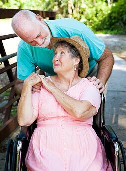 Senior man providing care for his wife