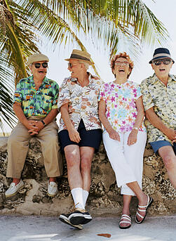 Group of laughing seniors on vacation together
