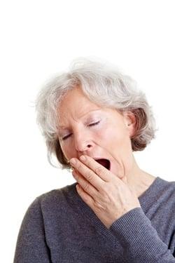 yawning senior woman