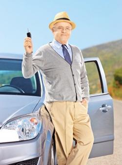 senior man with his new car