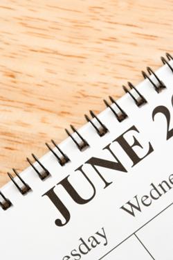 june calendar on desk
