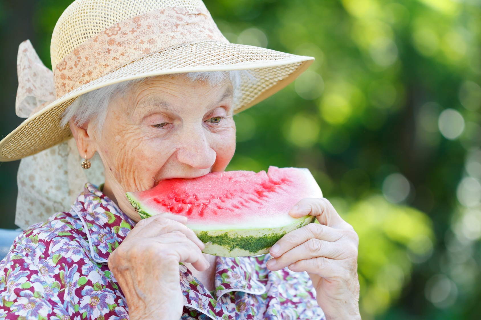 elderly-woman-eating-watermelon