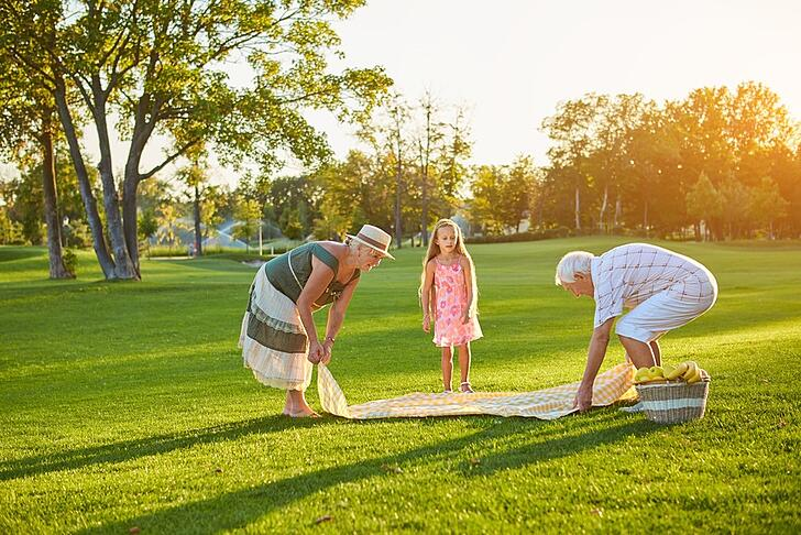 elders preparing picnic with granddaughter