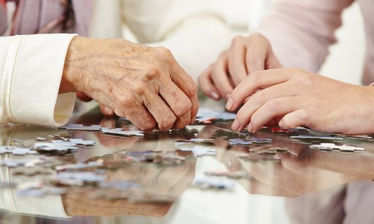 adult woman solve puzzle